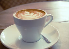 Cup of cappuccino, lo-fi effect. A cup of cappuccino in a cafe Stock Photography