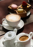 Cup of cappuccino and macaroons Royalty Free Stock Photography