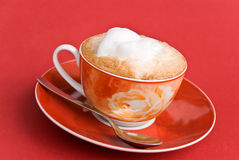 A cup of cappuccino with milk foam Stock Photos