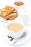 Cup of cappuccino, milk and fresh toast with jam on white Royalty Free Stock Photos