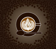 Cup of cappuccino with milk pattern surrounded by  Royalty Free Stock Photo
