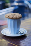 Cup of cappuccino with oat cookie. A cup of cappuccino with oat cookie Royalty Free Stock Photography