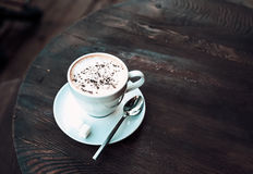 Cup of cappuccino on old dark wooden table Royalty Free Stock Photography