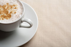 Cup of cappuccino over linen background Royalty Free Stock Photography