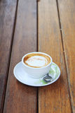 Cup of cappuccino over wooden table Stock Image