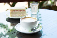 Cup of cappuccino over wooden table Royalty Free Stock Photo