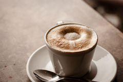 Cup of cappuccino over wooden table Stock Photography