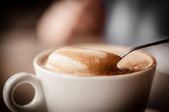 Cup of cappuccino over wooden table Royalty Free Stock Photography