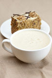 Cup of cappuccino, a piece of cake with nuts Stock Photo