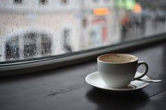 Cup of cappuccino, rain fall Stock Image