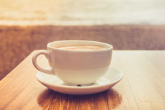 Cup of cappuccino by the sea Stock Images