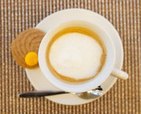 Cup of cappuccino shot from above Royalty Free Stock Images