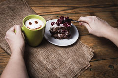Cup of cappuccino with smile and cherry cake Stock Photos