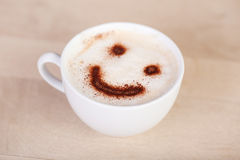 Cup of cappuccino with smiley Stock Image