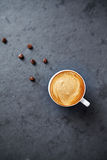Cup of cappuccino on a stone surface Royalty Free Stock Photo
