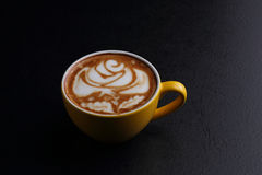 Cup of cappuccino and sugar bowl on black background Stock Photography