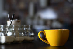 Cup of cappuccino and sugar bowls Stock Photography