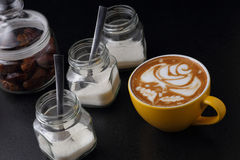 Cup of cappuccino and sugar bowls Royalty Free Stock Photo
