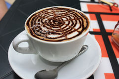 A cup of cappuccino. On the table Royalty Free Stock Images