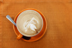 Cup of cappuccino on a tablecloth Royalty Free Stock Image