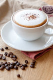 A cup of cappuccino topped with cacao powder Royalty Free Stock Photo