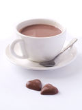 Cup of cappuccino with two chocolate hearts Stock Photo