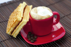 Cup of cappuccino wafers and coffee beans Royalty Free Stock Photo