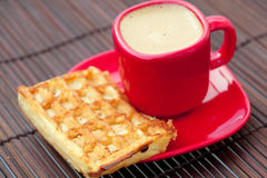 Cup of cappuccino and waffles on a bamboo mat Royalty Free Stock Photography