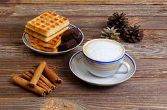 Cup of cappuccino, waffles and chocolate candy Stock Photography