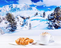 Cup of cappuccino with whipped cream and croissants Stock Photos