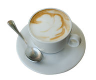 The cup of cappuccino on the white background. Stock Images
