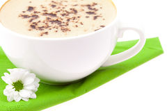 Cup of cappuccino and a white flower Stock Photos