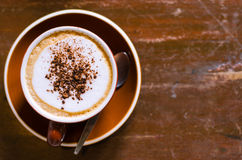 Cup of Cappuccino. A cup of cappuccino on the wood table Royalty Free Stock Photography