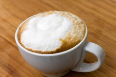 Cup of Cappuccino on the wooden Background Royalty Free Stock Images