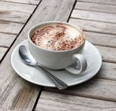 Cup of Cappuccino on wooden slat table Stock Photo