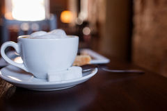 Cup of Cappuccino on wooden table. Cafe. Royalty Free Stock Photos