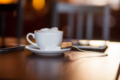 Cup of Cappuccino on wooden table. Cafe. Stock Photos