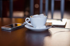 Cup of Cappuccino on wooden table. Cafe. Royalty Free Stock Images