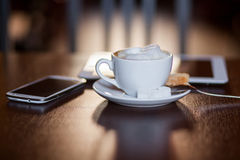 Cup of Cappuccino on wooden table. Cafe. Stock Image