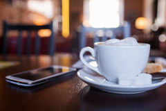 Cup of Cappuccino on wooden table. Cafe. Royalty Free Stock Photography