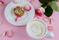 Cup of cappuccino and yummy cake with pink roses Royalty Free Stock Photo