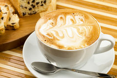 Cup of cappucino. And cakes on wooden background stock photos