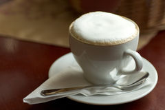 Cup of Cappucino. Shallow DOF. Focus on front stock photo