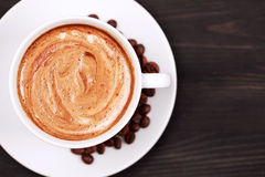 Cup of cappucino with foam, closeup Stock Photography