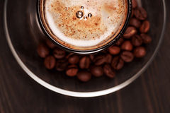 Cup of cappucino with foam, closeup Stock Images