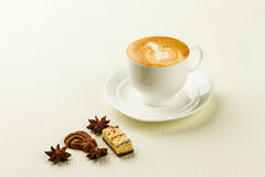 Cup of cappucino, sweet and spices Royalty Free Stock Images