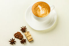 Cup of cappucino, sweet and spices Stock Photography