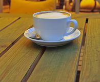Cup of cappucino on the table Royalty Free Stock Image