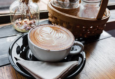 A cup of cappucino on a wood Royalty Free Stock Photo