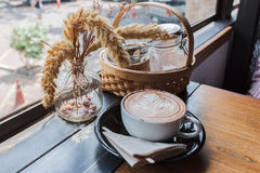 A cup of cappucino on a wood table Stock Image